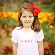 Monogrammed short sleeve ruffle shirt is personalized with the caboodle font in red thread.