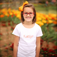 Monogrammed short sleeve lettuce edge shirt is personalized in the designer new font with orange thread.