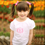 Monogrammed girls short sleeve pleated sleeve shirt with hot pink thread.