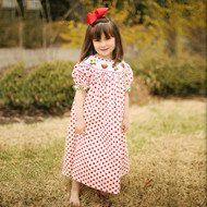 White with red polka dots dress has smocked big strawberries and clusters of strawberries on a vine with flowers.