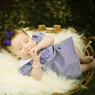 Our baby girl fell asleep in the photo prop basket wearing her purple gingham monogrammed dress, beautiful picture!