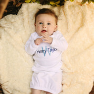 Monogrammed white baby gown in the Designer New font with navy and blue thread.