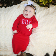 Monogrammed red baby gown in the Caboodle font with white thread.