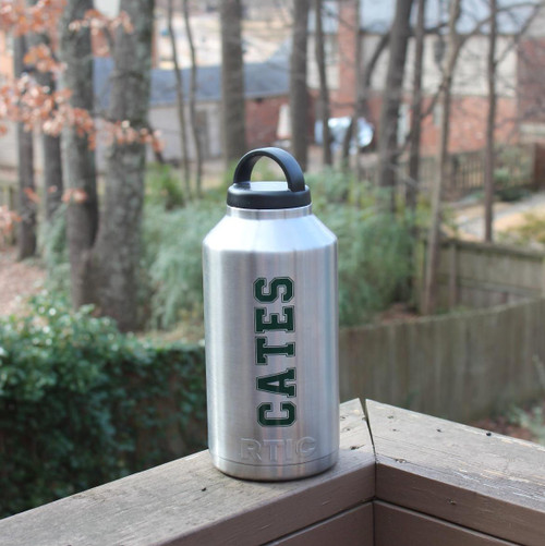 Stainless steel water jug with a name decal.