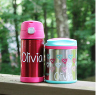 Decal with the My First Crush font on a thermos and lunch container.