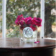 Glass vase/candle holder with a silver monogram.