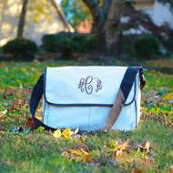Khaki and brown trim monogrammed messenger bag can hold electronics, folders and notebooks.
