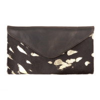 Chapa Leather hair-on clutch in hairy black/gold