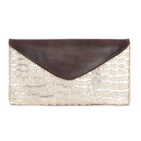 Chapa hair-on clutch in gold palermo