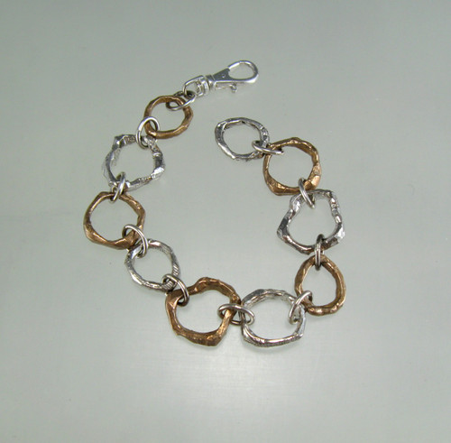 Whittled Sticks link bracelet with all small links in sterling and bronze