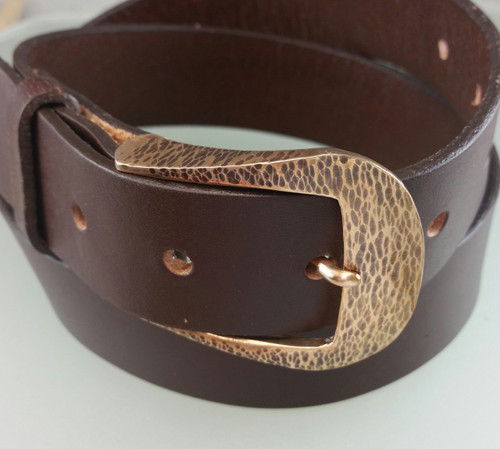 The Farrier Quarter Horse buckle in bronze. Given a light brown patina and satin brushed finish. This heavy bronze buckle fits 1 1/4 inch belt. belts sold separately