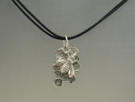 "Honey bee on comb  shape ""I"" in sterling silver  Comes on a cotton cord with an abalone button clasp"