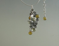 This is a one of kind with options such as the citrine stones,  gold on the bee and the comb cell, snake chain, and  bee seperated from the comb for motion interest. Each option is priced seperately so you can build your own design according to the lilmits of your budget or you imagination