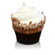 Moist spice cake infused with pineapples, bananas and pecans topped with cream cheese frosting and pecans