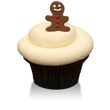 Moist gingerbread cake with cream cheese icing and a gingerbread boy fondant on top