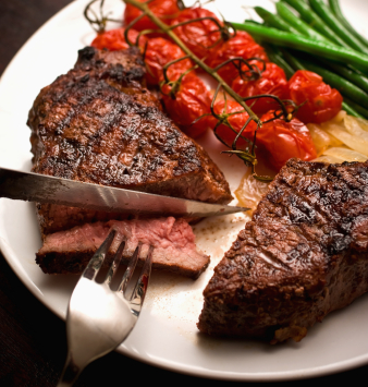 organic-grass-fed-beef-steak-cut-knife-fork.jpg