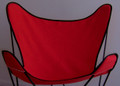 Red butterfly chair cover with black trim