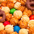 Rainbow Confections' own White Cheddar Popcorn and Pot of Gold caramel corn, mixed with chocolate covered pretzels and peanut M&Ms