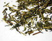 loose tea leaves rolled and mixed with twigs and sticks