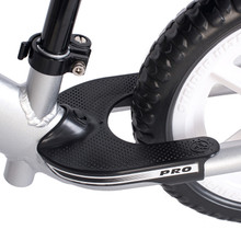 Exclusive Performance Footrest makes the PRO the best handling bike in the Strider lineup. This footrest is properly positioned directly below the saddle for natural bike balance. This position also fosters the advanced ability to stand while gliding as well as pumping and jumping the bike.