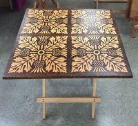 Artistic burning into folding oak table