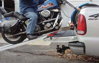 Mackie using Rider Tailgate Lowering Links to load a Harley