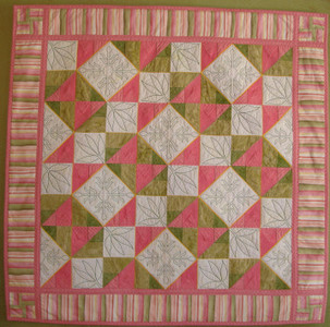 Mother & Child! A block from the 2012 Mystery Quilt repeats to make a beautiful quilt.