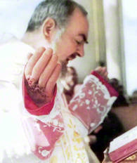 "Actual photo taken in 1950 of Saint Padre Pio at Mass without his gloves which shows the scabs of blood on his blessing hand!  ONE OF PADRE PIO'S  SCABS OF BLOOD MIRACULOUSLY  WENT THROUGH TIME AND SPACE AND EXTREMELY MIRACULOUSLY APPEARED UNDER PADRE PIO'S ""BLESSING HAND GLOVE"" AT MARY'S WAY WORLDWIDE APOSTOLATE!!!"
