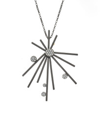 Modern chic starburst necklace with pave diamonds in midnight sterling silver and 18k gold detail