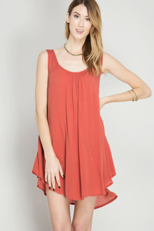 SLEEVELESS SHIFT DRESS WITH SIDE OVERLAP HEMLINE