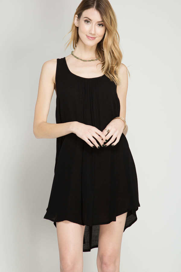 BLACK SLEEVELESS SHIFT DRESS WITH SIDE OVERLAP HEMLINE