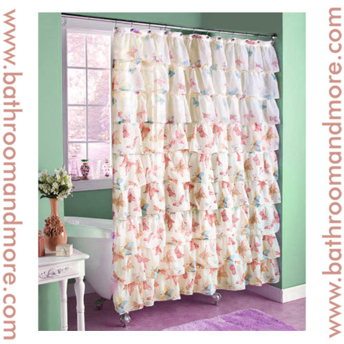 Butterfly shower curtain with ruffled fabric tiers.