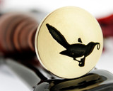 The Thieving Magpie - wax seal found on Moriarty's clues to Sherlock in The Reichenbach Fall. It's a Magpie, with a bit of stolen treasure in its beak. And the song that Moriarty plays while he is breaking in to the Tower of London, the Bank of England, and Pentonville Prison? …The Thieving Magpie Overture, by Gioachino Rossini.  Photograph reversed for viewing purposes.