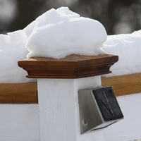 winter snowy wood pyramid fence post top protected from water damage