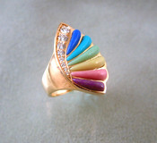 What's to say !! Colors of the minerals are striking. Diamonds add a graceful curve. Overall Marquis shape is lovely.