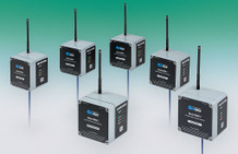 Model 8800-2 Network Supervisor (center), surrounded by five Model 8800-1 Sensor Nodes.