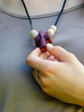 PURPLE ROPED CLAY ON WOODEN CROSS NECKLACE WITH FOUR BEADS