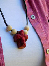 MAROON ROPED CLAY ON WOODEN CROSS NECKLACE WITH FOUR BEADS
