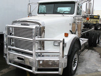 Freightliner FLD 120 SBA Herd 4 Post Defender Bumper Grill Guard With Horizontal Bars On Truck