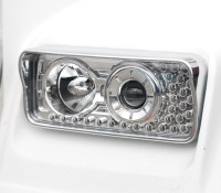 Freightliner Classic XL Projector Headlights With LED Turn Signal & Visor On Truck Close Up