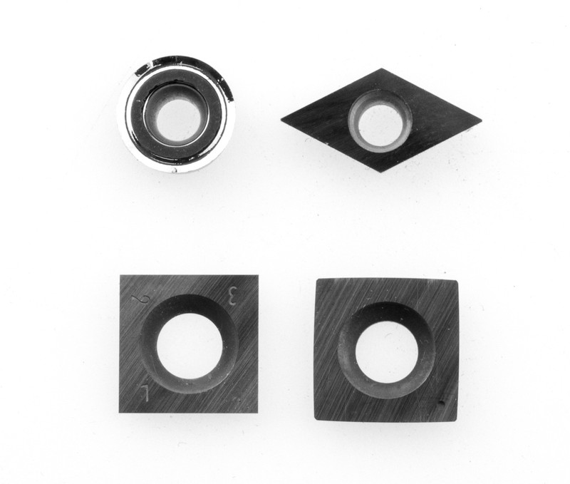 """Replacement carbide cutters for the 4 tool set. Shown here with the 6"""" radius square cutter for the Simple Rougher."""