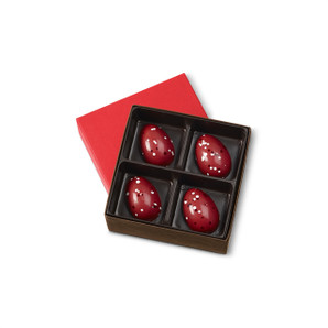 Hand-painted dark chocolate shell filled with a delicate and delightful strawberries and cream ganache.