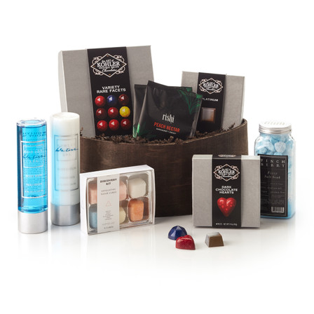 Basket Includes:  VARIETY RARE FACETS Nine Pieces, PLATINUM Four Pieces, DARK CHOCOLATE HEARTS Four Pieces, Kohler Waters Spa Hollyhock Lotion, Kohler Waters Spa Hollyhock Body Wash, Two bags of Rishi Tea, Harper + Ari™ Exfoliating Sugar Cubes and Finchberry Fizzy Salt Soak