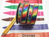Colored pencils and rainbow ribbon make all the primary colors sing! Designed and printed in the USA