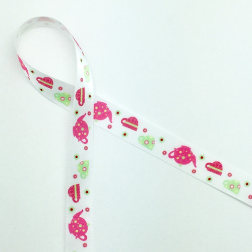 "Tea pots and tea cups are featured  in pink and green on a 5/8"" white single face satin ribbon. Treat Mom to some spiced tea and cookies tied with this sweet ribbon to capture her heart on Mother's Day!"