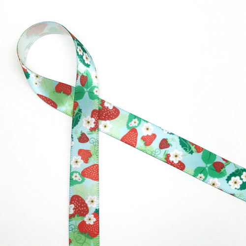 """Strawberry pattern with a light blue background printed on 5/8"""" Single Face Satin ribbon on 10 yard spools"""
