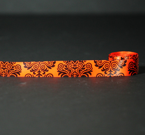 "Damask print in black on 7/8"" orange single face satin ribbon, 10 Yards"