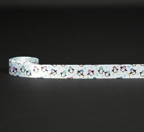 "Penguins dance along our 5/8"" ribbon among the blue snowflakes!"