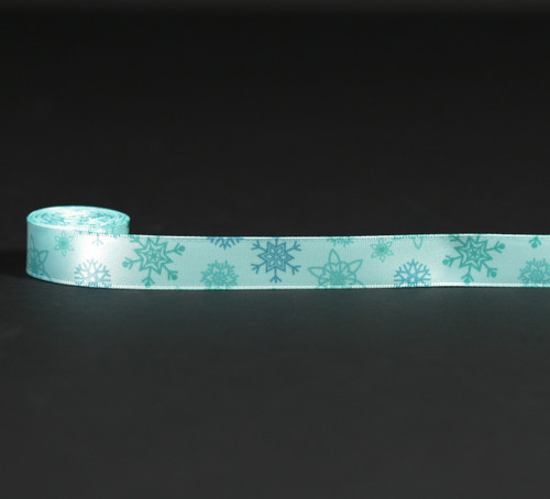 "Snowflakes in medium blue on 5/8"" ice blue single face satin ribbon."