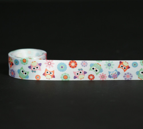 """Our owls are a real hoot in pastel colors on 7/8"""" white single face satin ribbon in 10 yard spools!"""